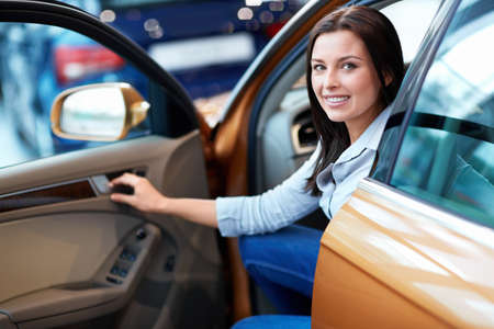 Attractive girl behind the wheel Stock Photo - 15880512