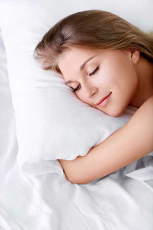Young girl sleeping in bed photo