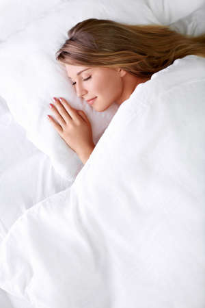 sleeping face: Young girl sleeping in bed