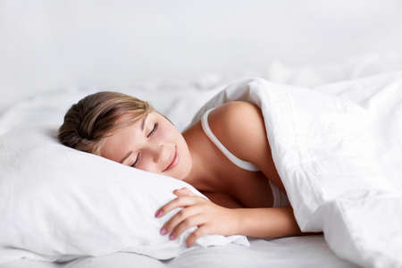 Young girl sleeping in bed Stock Photo - 15880566