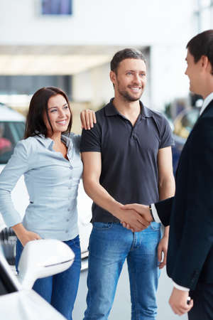 Young couple and the seller Stock Photo - 16058556