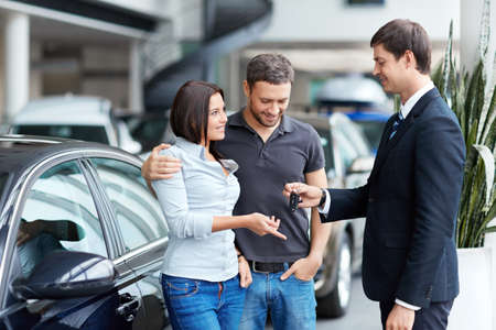 Young couple buys a car Stock Photo - 16058591
