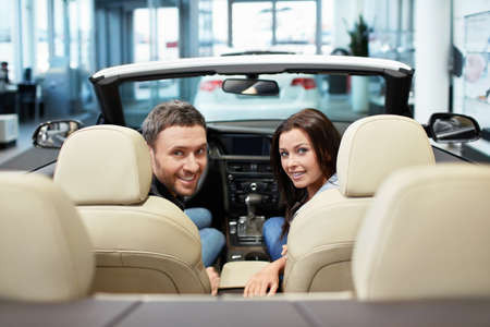 Young couple in a convertible photo