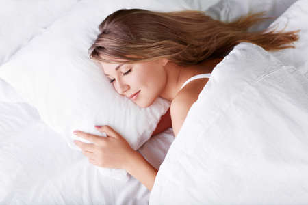 females only: Young girl sleeping in bed