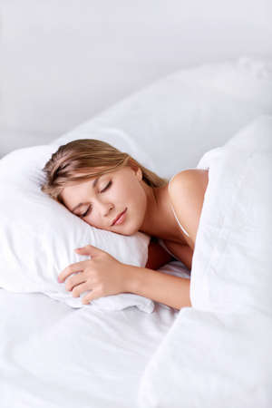 sleeping woman: Young girl sleeping in bed