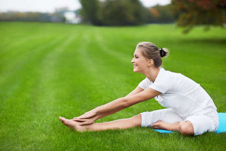 healthy lifestyle: Young girl doing gymnastics in the park