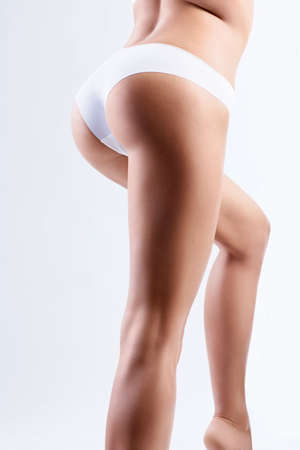 mujer celulitis: Aislado Hermosa trasero deportivo Foto de archivo