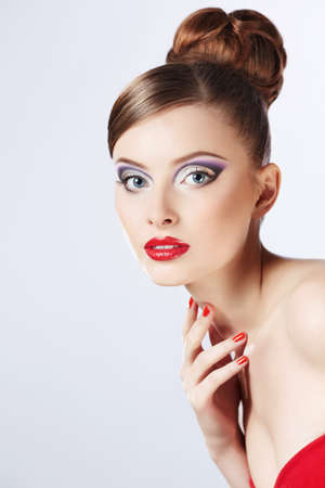 Beautiful girl with a hairstyle and make-up photo