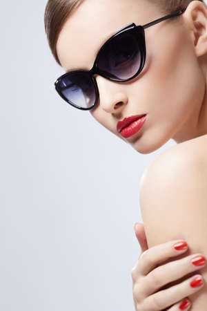 �aucasian: Young girl in sunglasses indoors Stock Photo
