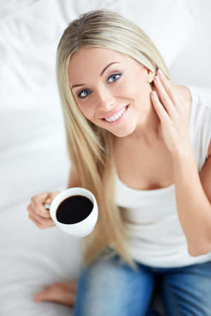 �aucasian: Young girl with a cup at home Stock Photo