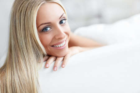 �aucasian: Beautiful young girl on the couch Stock Photo