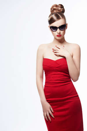 �aucasian: Beautiful girl in a red dress on a white background