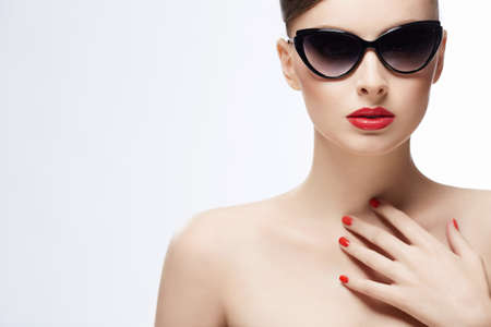 �aucasian: Beautiful girl in sunglasses on a white background Stock Photo