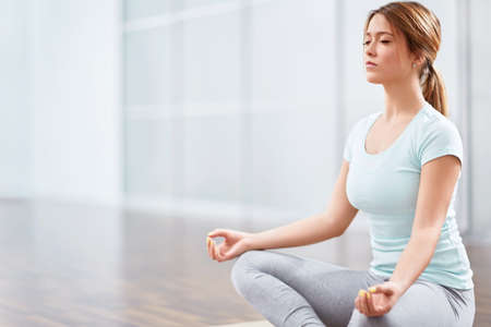 yoga girl: Young woman in a lotus position