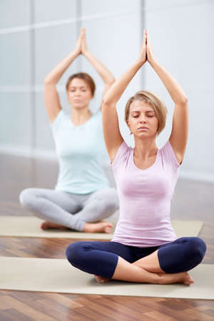 closed club: Young attractive girls do yoga Stock Photo