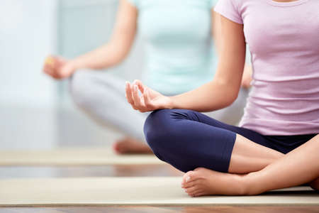 health club: Young people do yoga indoors