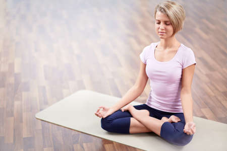 closed club: Young woman in a lotus position