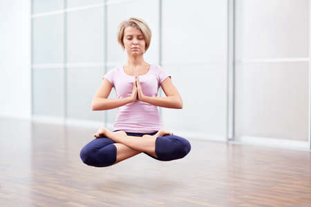 yoga girl: Woman floating in the air in lotus position Stock Photo