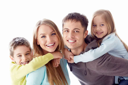 four people: Happy family with children on white background