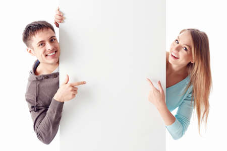 message: Young couple on a white background Stock Photo