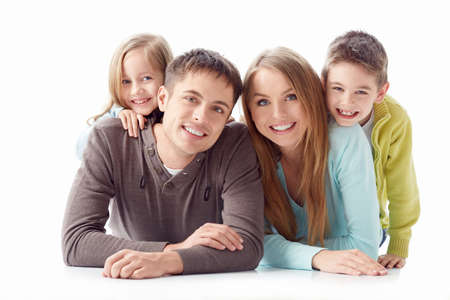 little girl smiling: Family with children on a white background Stock Photo
