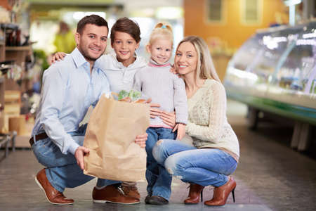 Family with children in shop Stock Photo - 18357773