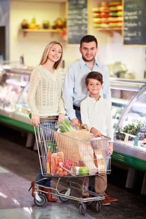 Family with child in a store Stock Photo - 18357786