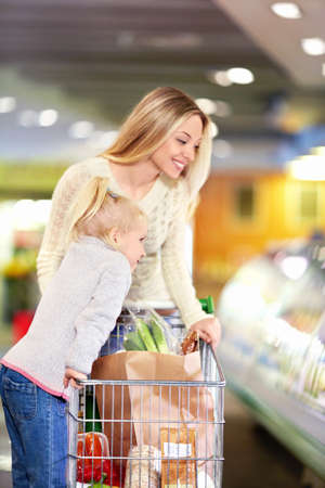 groceries: Mother and daughter in the store