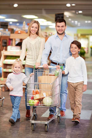 Family with children in a store photo
