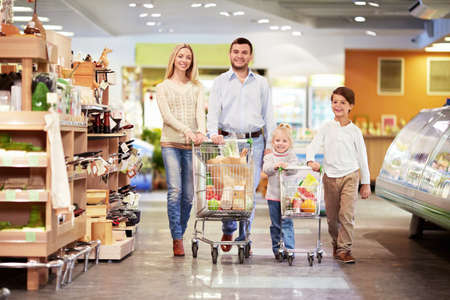 groceries shopping: Family with children in a store Stock Photo
