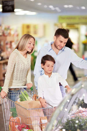 supermarket shopping: Family with a child in a store