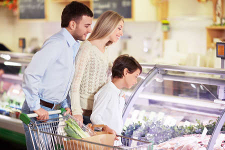 Family with a child in a store Stock Photo - 18661114