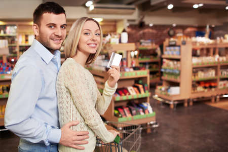 Young couple with a credit card in a store Stock Photo - 18661113