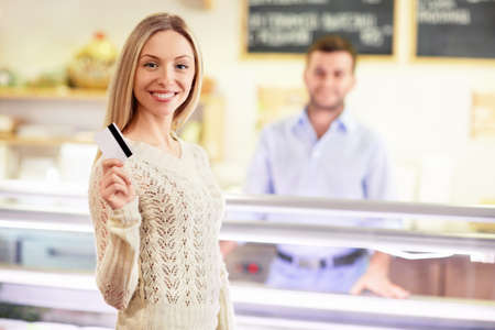 Woman with a credit card in a store photo