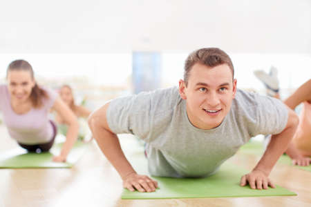pushups: Young people engaged in the gym