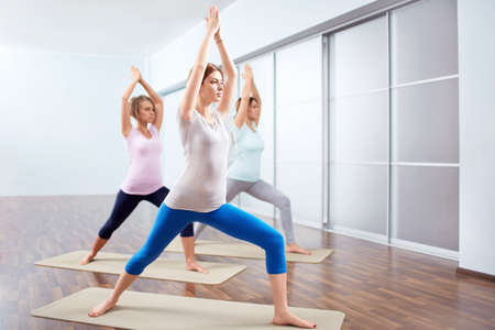 Young attractive woman do yoga photo