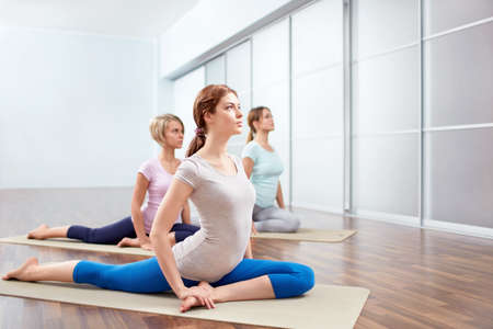 indoors: Young girls do yoga indoors Stock Photo