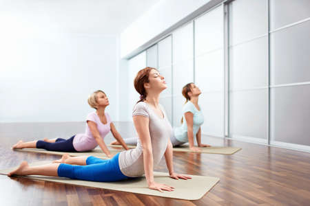 Young girls do yoga indoors photo