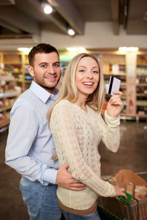 Young couple with a credit card photo