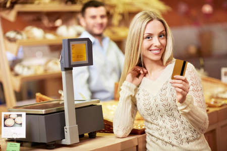 supermarket checkout: Attractive girl with a credit card