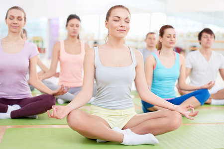 closed club: Young people in the lotus position Stock Photo