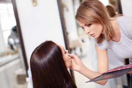 visagiste: Visagiste make-up girl in a beauty salon