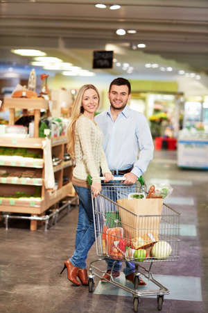 Young couple buying products in the store photo