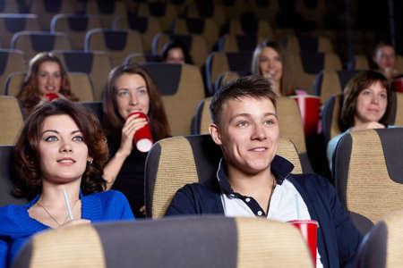 cinema people: Young people in cinema Stock Photo