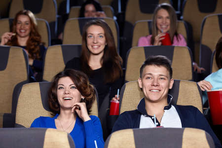 Smiling people in cinema photo