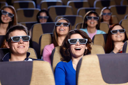 cinema people: Young people in 3D glasses in cinema Stock Photo