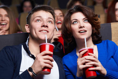 Young couple at the cinema photo