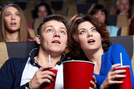 movie theatre: Young couple at the cinema