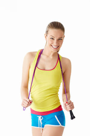 Young girl with a skipping rope on a white background