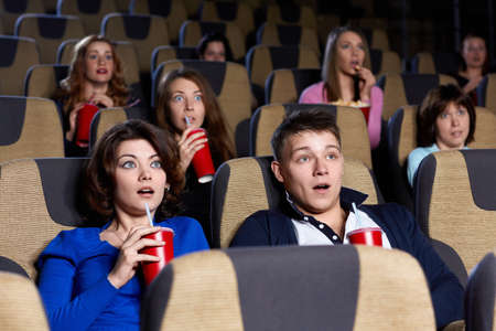 People watching movie at the cinema photo
